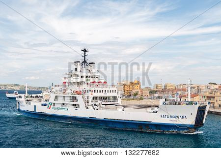 VILLA SAN GIOVANNI, ITALY - SEPTEMBER 30 2015: Ferry boat at the harbor of Villa San Giovanni in the strait of Messina