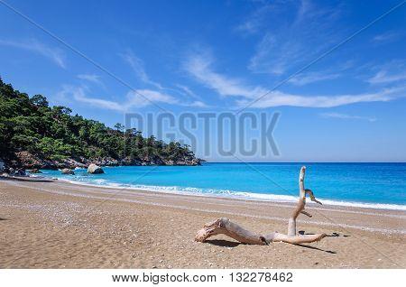 Paradise beach on the Lycian trail in Turkey. White sandy beach, blue sky, blue sea.