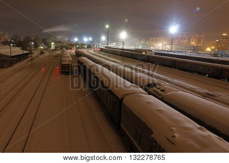 Railway In Winter Night And White Snow