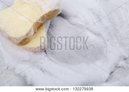 Wash. Yellow sponge with foam