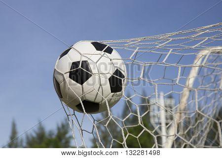 Soccer foot ball in the goal net