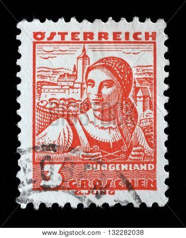 ZAGREB, CROATIA - SEPTEMBER 13: A stamp printed in Austria shows a woman in the Austrian national dress with the inscription