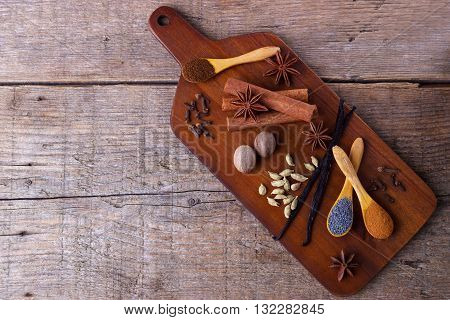 Variety of spices for baking on cutting board, background