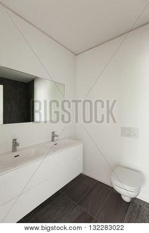 Interior of new apartment, white modern restroom