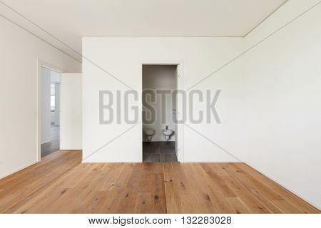 Interior of empty apartment, wide room with parquet floor