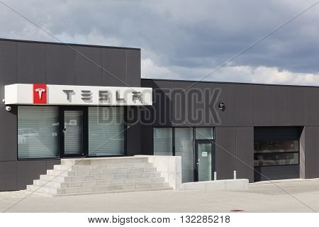 Aarhus, Denmark - May 16, 2016: Dealership of Tesla cars in Aarhus. Tesla is an American automotive and energy storage company that designs, manufactures, and sells luxury electric cars
