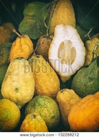 Fresh lemons with green leaves closeup