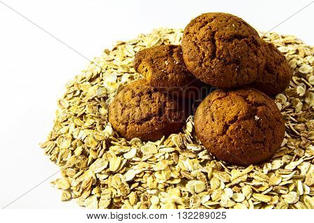 Nice oatmeal porridge and oatmeal Cookies close up on white isolated background