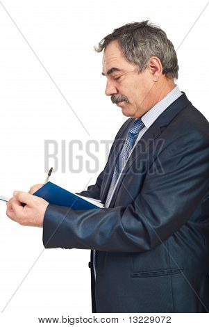 Profile Of Mature Busienss Man Writing