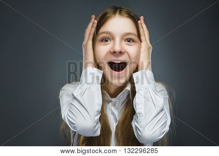 Closeup Portrait of happy girl going surprise isolated on gray background.