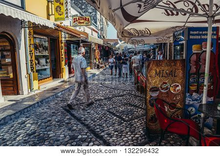 Mostar Bosnia and Herzegovina - August 25 2015. People walks at famous paved Mala Tepa Street with many tourist shops and restaurants in Mostar