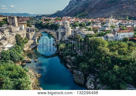 Mostar Bosnia and Herzegovina - August 25 2015. View with Stari Most (english: Old Bridge) reconstructed 16th century Ottoman bridge main attraction of Mostar Old Town
