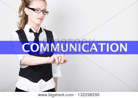 communication written on a virtual screen. Internet technologies in business and tourism. woman in business suit and tie, presses a finger on a virtual screen.