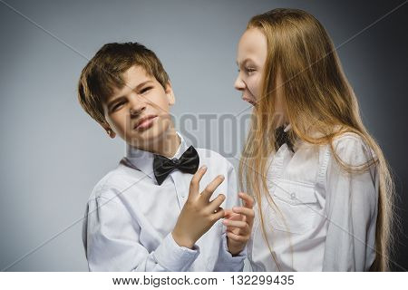 angry girl shouting at frightened dissatisfied boy. Negative human emotion, facial expression. Closeup. Communication concept.