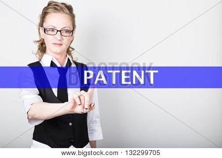 patent written on a virtual screen. Internet technologies in business and tourism. woman in business suit and tie, presses a finger on a virtual screen.