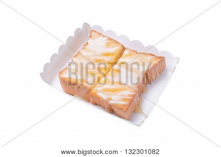Sweetened condensed milk on slice bread toast isolated on white background.