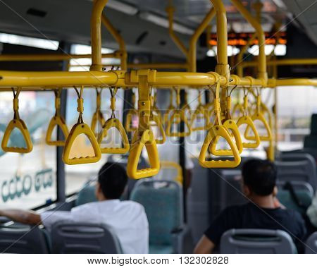 Straps to hold to maintain balance in a commuter bus