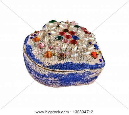 Children closed casket in the form of heart decorated with colored stones and beads isolated on white background