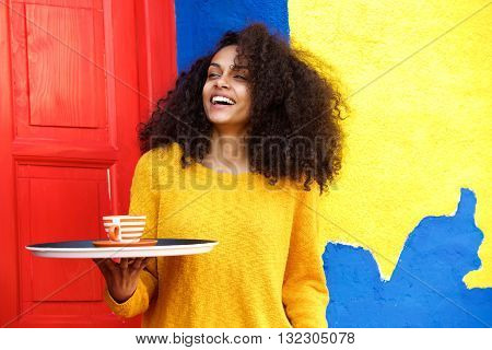 Female Waitress With Tray In A Coffeeshop