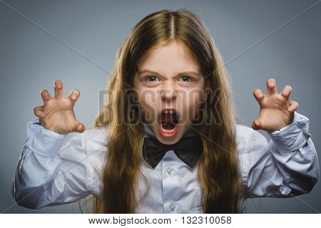 Portrait of angry girl with hand up yelling isolated on gray background. Negative human emotion, facial expression. Closeup.