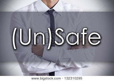 (un)safe - Young Businessman With Text - Business Concept