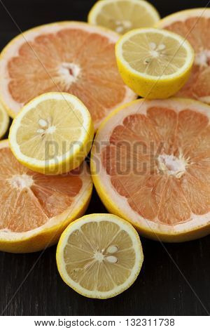 Group of fresh citrus fruits on a table mandarines clementines tangerines oranges lemons grapefruits
