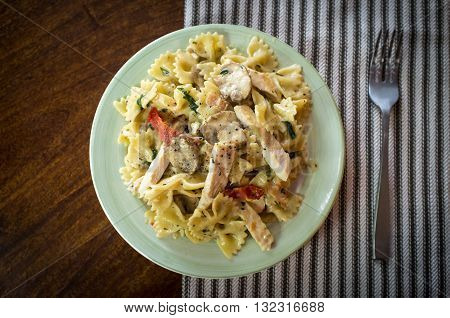 Chicken farfalle alfredo with mushrooms and sundried tomatoes