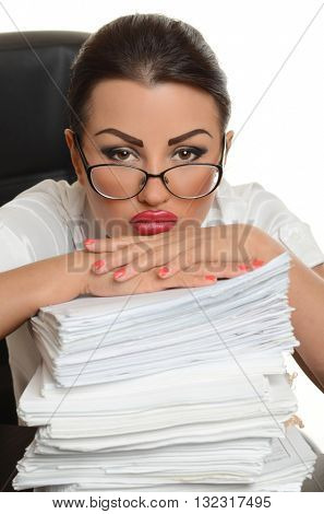 Portrait of a confident young woman  with documents on white