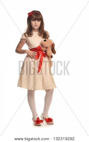 Beautiful little girl in fashion dress holding lovely toy