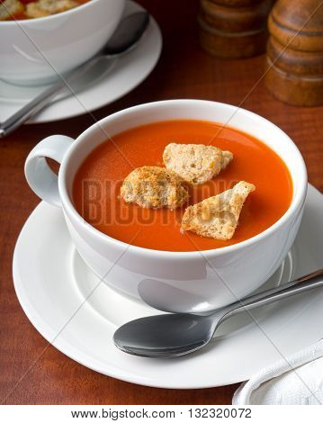 A bowl of delicious tomato soup with home made croutons.