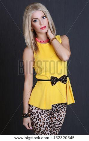 Beautiful sensual woman in a yellow dress