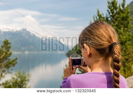 Girl Taking Photo With Compact Camera