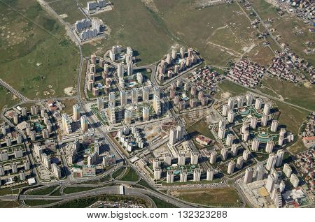 Aerial view of a new high-rise housing development with colourful blocks of flats built with swimming pools attached. Western suburbs of Istanbul Turkey.