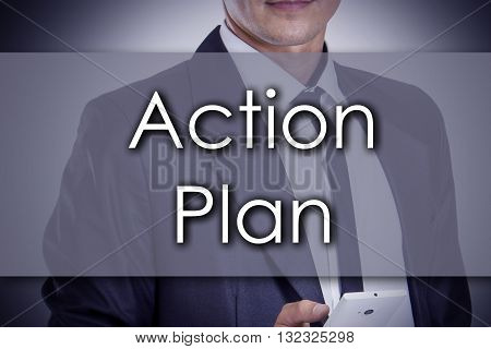 Action Plan - Young Businessman With Text - Business Concept