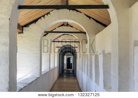 ROSTOV, RUSSIA - JUNE 3, 2013: Rostov Kremlin. This is passageway of the fortress wall with wooden roof.