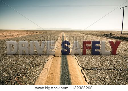 3d illustration of drive safely sign on a desert road