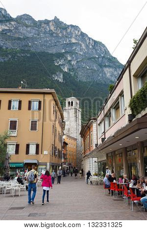 Riva del Garda Italy - May 03 2016: Tourists walking on the Brolio square in little resort town located in the Northern part of the Lake Garda