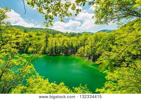 Beautiful landscape, waterfall and clear green water in the Plitvice Lakes National Park in Croatia, panoramic view