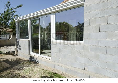 a construction veranda with windows and concrete