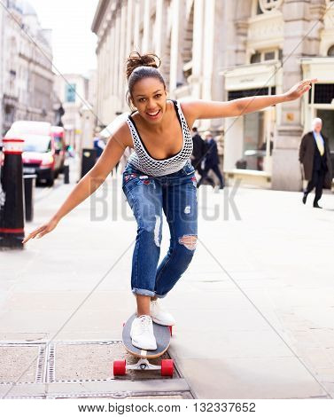 young woman skate boarding in the street