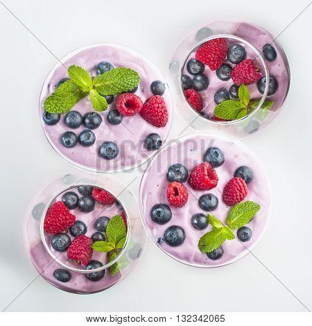 Extreme close-up image of fruit yogurt on white background