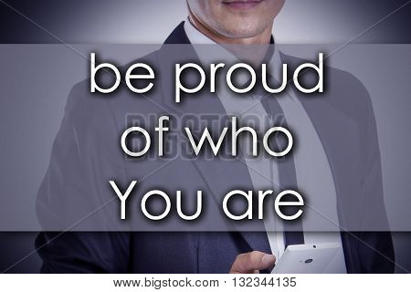 Be Proud Of Who You Are - Young Businessman With Text - Business Concept