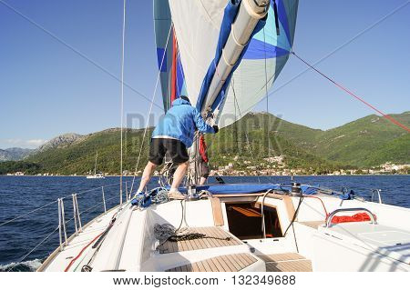 Tivat, Montenegro - 26 April, Man on a yacht sailing in the yards, 26 April, 2016. Regatta
