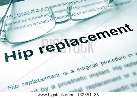 Hip replacement written on a page. Medical concept.