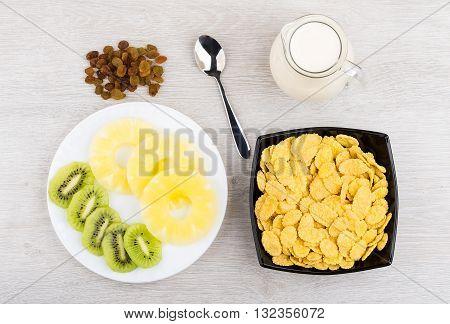 Jug Of Milk, Bowl With Corn Flakes, Pineapple And Kiwi