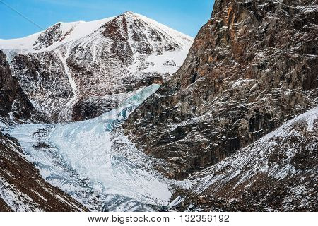 Beautiful snow-capped mountains and glacier against the blue sky