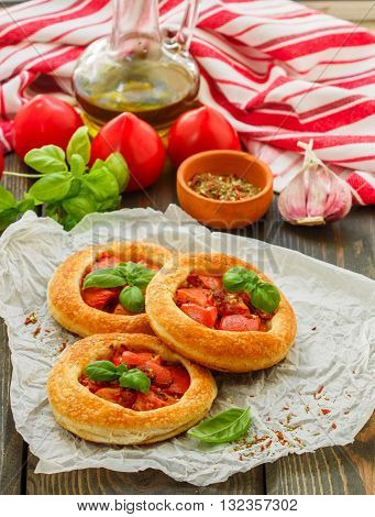 Homemade Pie Of Puff Pastry With Tomatoes, Basil And Spices. Mini Round Tomato Tart