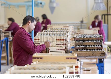 Worker Checking Rpg Explosives In Munition Factory