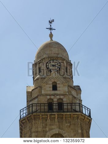 Clock tower with a weathercock in Jerusalem Israel