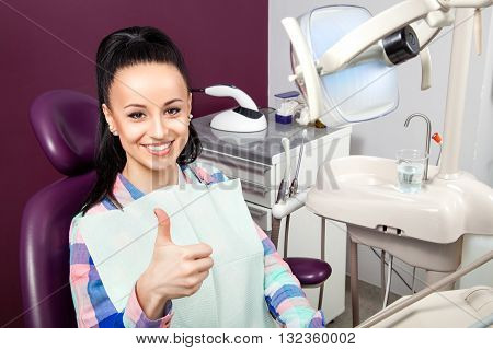 Woman With White Teeth With Thumb Up Waiting For Dentist
